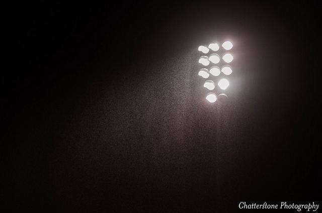 rainy night stadium lights Grant Frederiksen