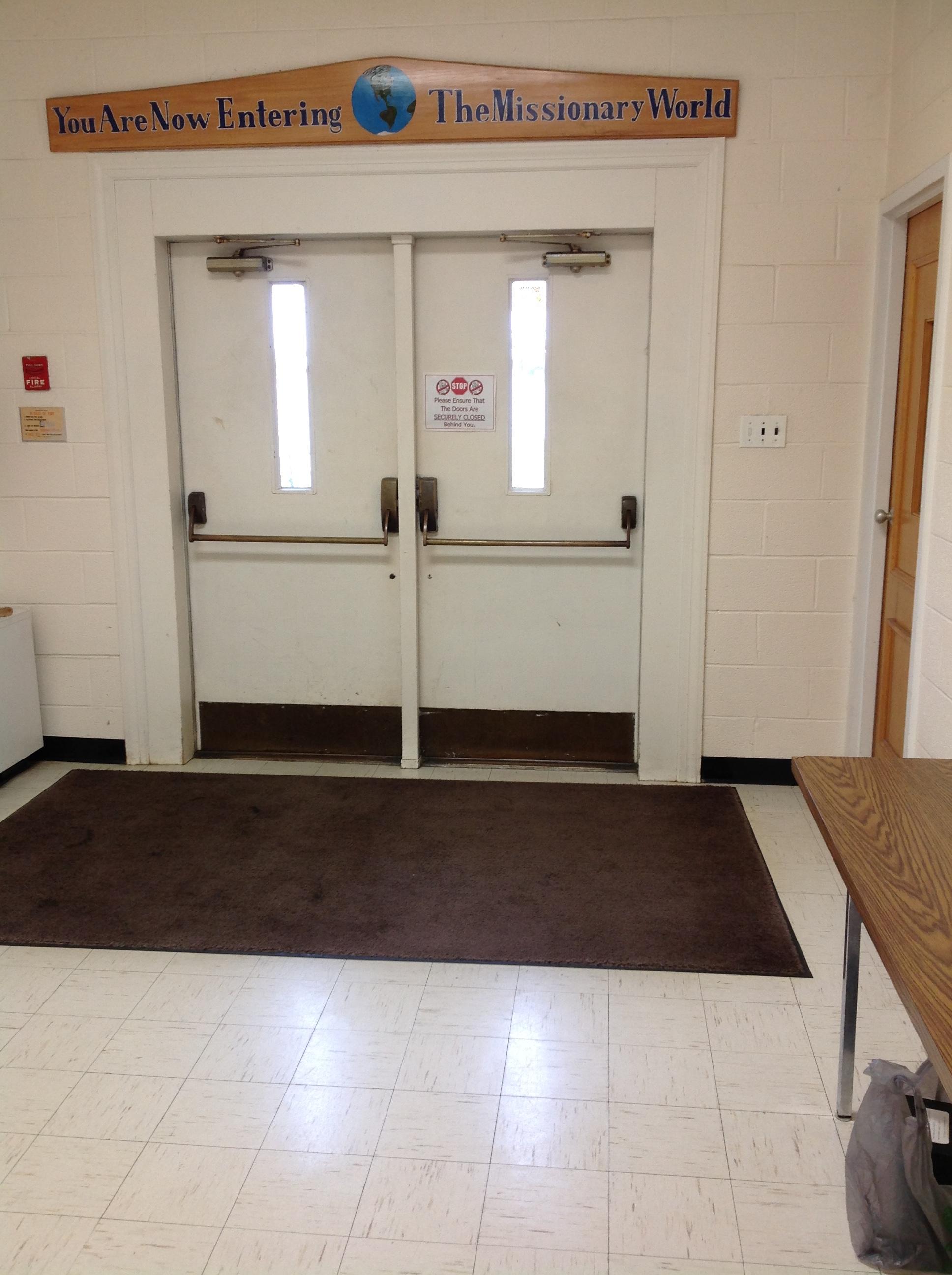 DIW sits in hallway near door.jpg
